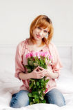 The beautiful young woman with union of roses Stock Photo
