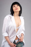 Beautiful Young Woman Unzipping Royalty Free Stock Image