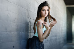 Beautiful young woman in urban background Royalty Free Stock Photography