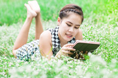 Beautiful Young Woman use Tablet Computer In Park Royalty Free Stock Photos