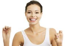 Beautiful young woman using dental floss Stock Image
