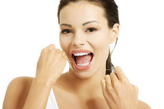 Beautiful young woman using dental floss Royalty Free Stock Photo
