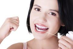 Beautiful  woman using dental floss Royalty Free Stock Photography