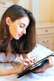 Beautiful young woman using digital tablet computer Royalty Free Stock Photo