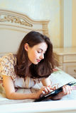 Beautiful young woman using digital tablet computer Stock Photography