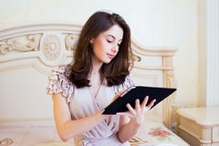 Beautiful young woman using digital tablet computer Stock Photos