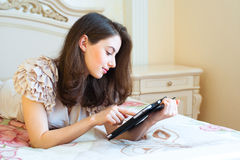 Beautiful young woman using digital tablet computer Stock Images
