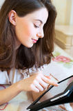 Beautiful young woman using digital tablet computer Royalty Free Stock Images