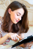 Beautiful young woman using digital tablet computer Royalty Free Stock Photography