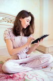 Beautiful young woman using digital tablet computer Royalty Free Stock Image