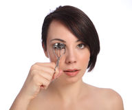 Beautiful young woman using eye lash curler Stock Photo