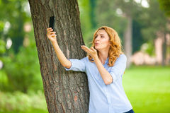 Beautiful young woman using her cellphone Royalty Free Stock Photos
