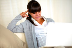 Beautiful young woman using her laptop at home Stock Photography