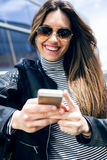 Beautiful young woman using her mobile phone in the car. Stock Photos