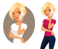Cute blonde girl using her cell phone Royalty Free Stock Image