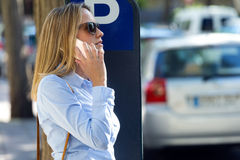 Beautiful Young Woman Using Her Mobile Phone In The Street. Stock Photography