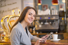 Beautiful young woman using her tablet pc in coffe Stock Photography