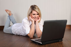 Beautiful young woman using internet at home Stock Photo