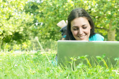 Beautiful young woman using laptop Stock Images