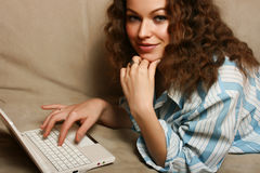 Beautiful young woman using laptop Stock Photo