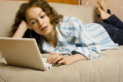 Beautiful young woman using laptop Stock Image