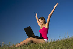 Beautiful young woman using a laptop, and happy. Beautiful young woman using a laptop stock photography