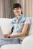 Beautiful young woman using a laptop Stock Images