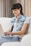 Beautiful young woman using a laptop Royalty Free Stock Photos