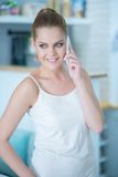 Beautiful young woman using a mobile phone Stock Image