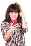 Beautiful young woman using retro orange and mobile phone telephone Royalty Free Stock Image
