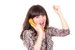 Beautiful young woman using retro orange telephone Stock Image