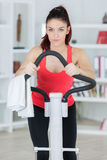 Beautiful young woman using step machine during workout. Beautiful young woman using a step machine during a workout Royalty Free Stock Image