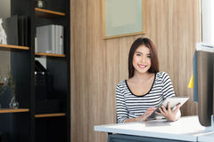 Beautiful young woman using a Tablet stock image