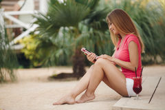 Beautiful young woman using tablet pc outdoor. Stock Images