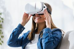 Beautiful young woman using virtual reality headset. Royalty Free Stock Photos