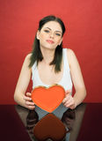 Beautiful young woman with a Valentines heart Stock Images