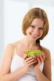 Beautiful young woman with vegetable salad. Portrait of a beautiful young woman with vegetable vegetarian salad royalty free stock photo