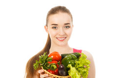 Beautiful young woman with vegetables isolated. Beautiful woman with vegetables isolated Stock Images