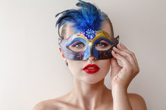 Beautiful young woman in venetian carnival mask Stock Images