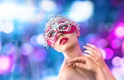 Beautiful young woman in venetian carnival mask Royalty Free Stock Photos