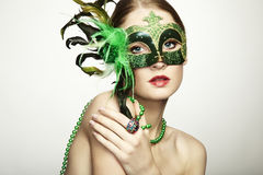The beautiful young woman in a venetian mask Royalty Free Stock Photography