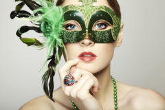 The beautiful young woman in a venetian mask Royalty Free Stock Photos