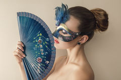 Beautiful young woman in venetian Stock Images