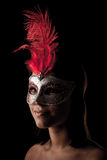 Beautiful young woman with venice carnival mask studio portrait Royalty Free Stock Image