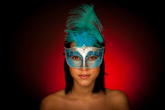 Beautiful young woman with venice carnival mask studio portrait Stock Photography