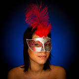 Beautiful young woman with venice carnival mask studio portrait Stock Photos