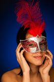 Beautiful young woman with venice carnival mask studio portrait Stock Image