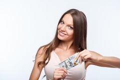 Beautiful young woman is very rich and happy Stock Image
