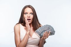 Beautiful young woman is very rich and shocked Stock Images