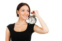Beautiful young woman with vintage alarm clock Royalty Free Stock Photos
